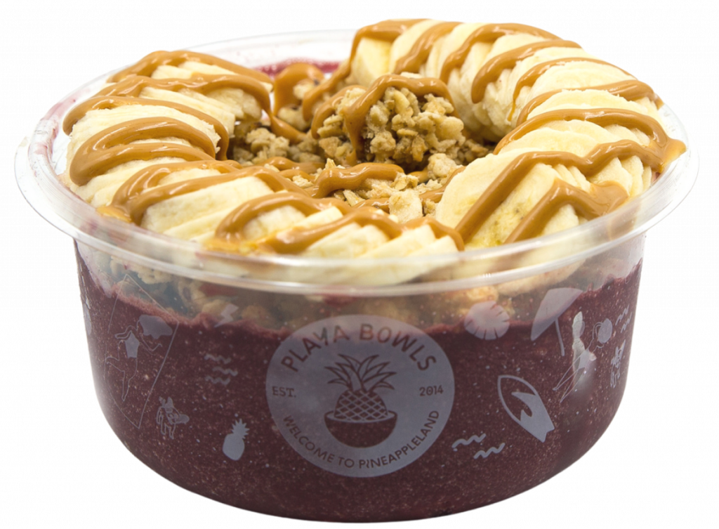 Pure acai with chocolate protein topped with granola, banana, peanut butter